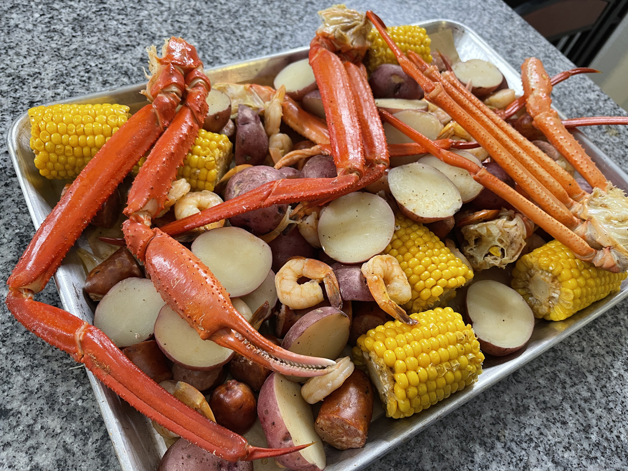 Photo of Sheet Pan with Crab Legs and Claw, Shrimp, Potatoes, and Corn