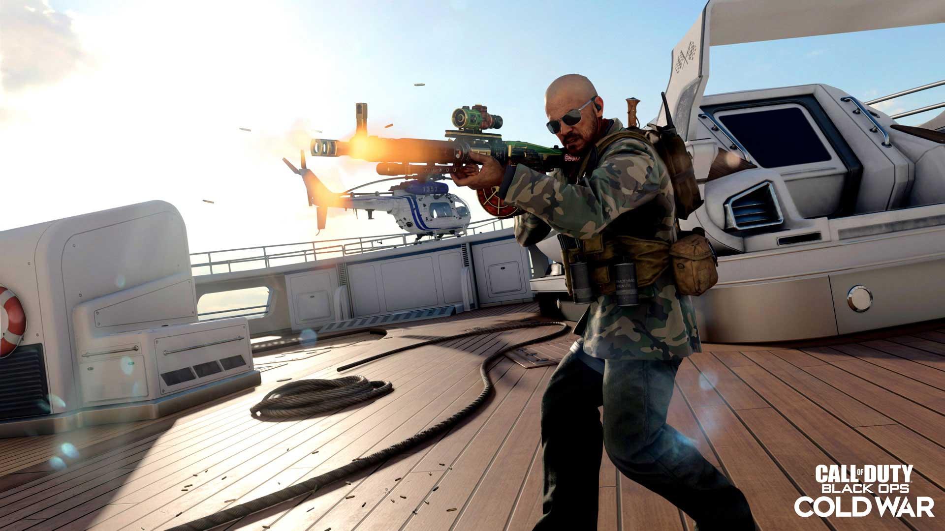 Man wielding gun on boat deck while wearing sunglasses